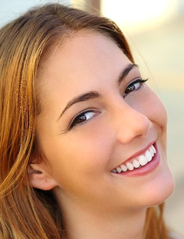 Woman who followed advice on how to choose a cosmetic dentist in Dallas