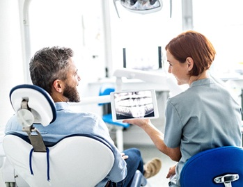 Dallas dentist and patient discuss dental implants in Dallas