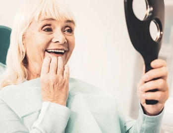Woman admires her new dental implants in Dallas