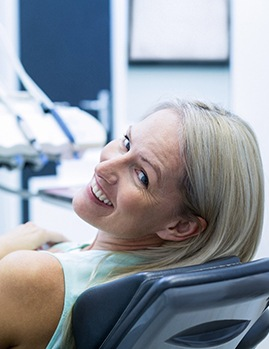 Older woman in dental chair with dental implants