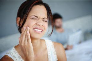 woman dental pain uncomfortable