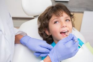 Child at visit with dentist in Dallas