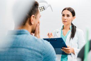 Dentist in Dallas speaking with patient