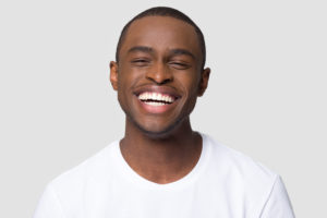 Laughing man enjoying the benefits of smiling