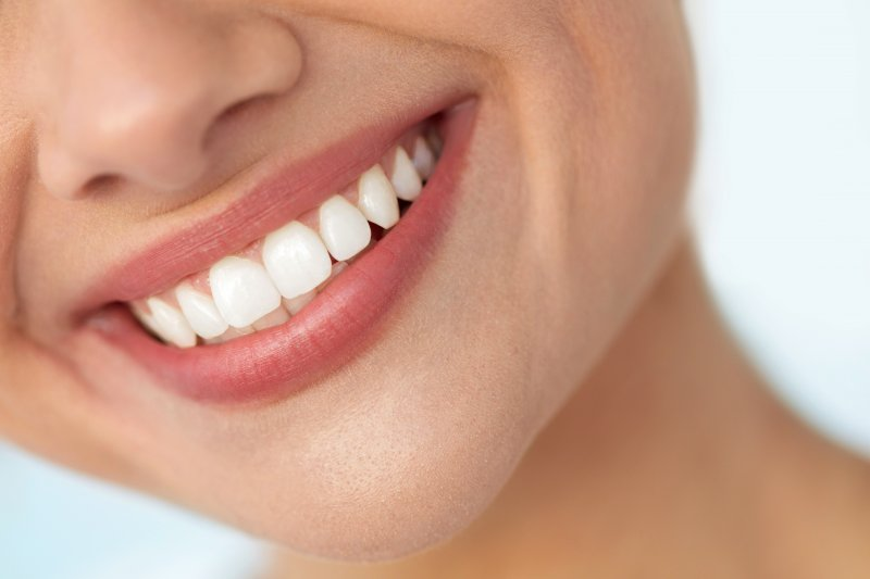 Closeup of woman with white teeth and balanced smile