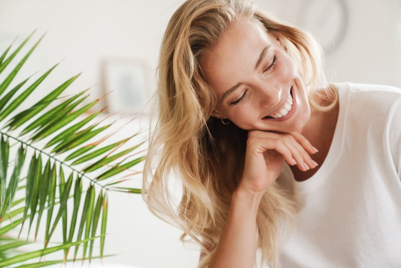 Young woman smiling in her apartment