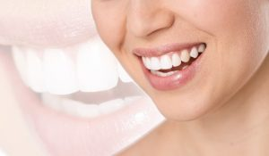 Woman with a beautiful smile using cosmetic dental treatments